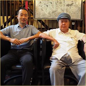 浦君艺术创始人胡桂忠与刘文西合影