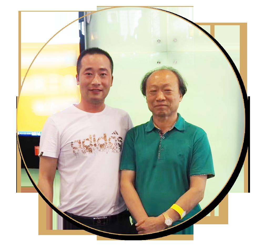 浦君艺术创始人胡桂忠与中国工笔画学会会长冯大中先生合影